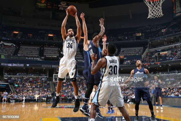 Brandan Wright of the Memphis Grizzlies grabs a rebound against the Dallas Mavericks on April 12 2017 at FedEx Forum in Memphis Tennessee NOTE TO...