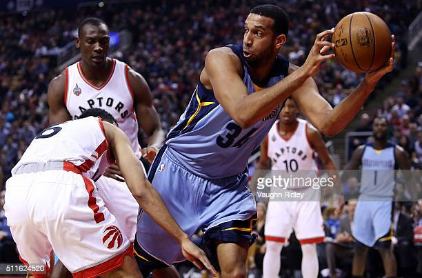 Brandan Wright of the Memphis Grizzlies passes the ball against Cory Joseph of the Toronto Raptors during an NBA game at the Air Canada Centre on...