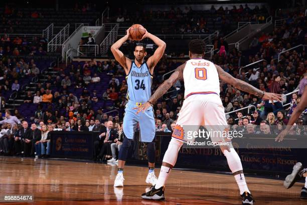 Brandan Wright of the Memphis Grizzlies passes the ball against the Phoenix Suns on December 26 2017 at Talking Stick Resort Arena in Phoenix Arizona...
