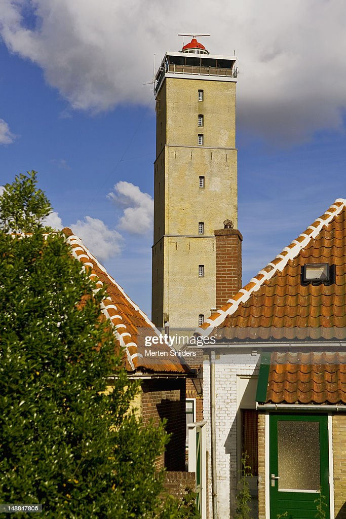 Brandaris lighthouse above rooftops. : Stockfoto