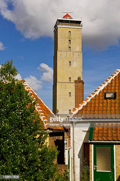 brandaris lighthouse above rooftops. - merten snijders stock pictures, royalty-free photos & images