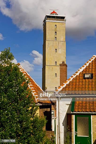 brandaris lighthouse above rooftops. - merten snijders stock-fotos und bilder