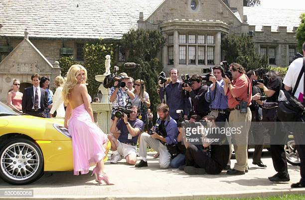 Brande Roderick posing with her Porsche Boxter with personalized license plates at the Playboy's 2001 Playmate of the Year luncheon held at the world...