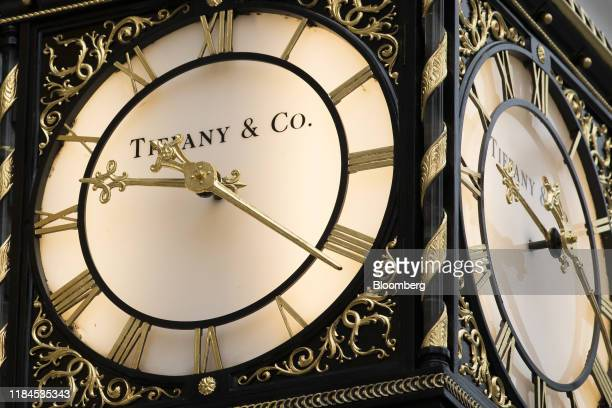 A branded clock hangs in front of a Tiffany Co luxury jewelry store in London UK on Monday Nov 25 2019 LVMH Moet Hennessy Louis Vuitton SE agreed to...