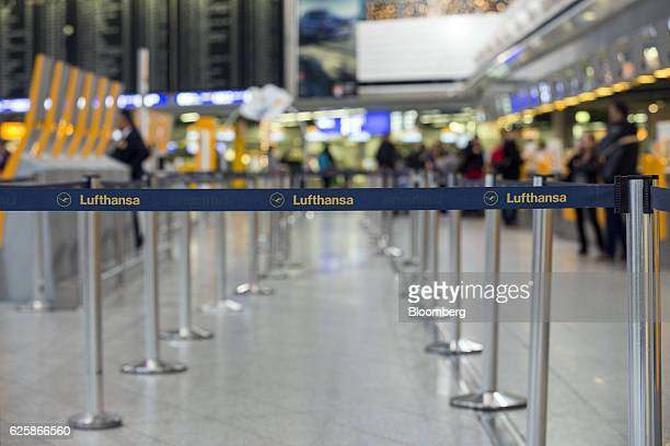 Branded cordons stand in the Deutsche Lufthansa AG passenger checkin area as Lufthansa pilots strike over renumeration and work conditions at...