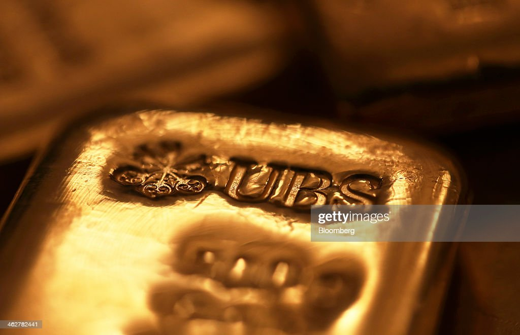 AG branded five hundred gram gold bar is seen in this arranged photograph at Gold Investments Ltd. bullion dealers in London, U.K., on Wednesday, Jan. 15, 2014. Gold futures extended a decline from a one-month high on speculation that the U.S. Federal Reserve will continue reducing stimulus, strengthening the dollar and cutting the metal's appeal as an alternative investment. Photographer: Chris Ratcliffe/Bloomberg via Getty Images