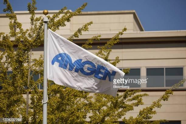 Branded flag flies outside Amgen Inc. Headquarters in Thousand Oaks, California, U.S., on Thursday, Aug. 27, 2020. Amgen is among the world's biggest...