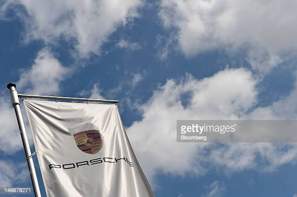 A branded flag hangs outside the Porsche AG headquarters in Stuttgart Germany on Friday June 22 2012 Porsche AG which is jointly owned by Volkswagen...