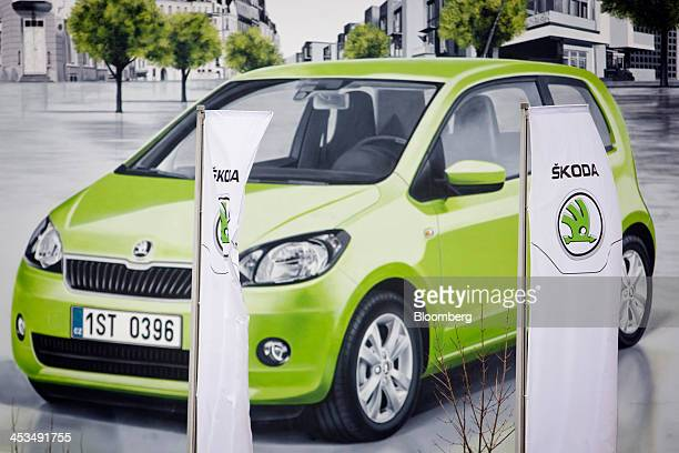 Branded flags fly near an advertisement for the Citigo automobile outside the Skoda Auto AS plant in Mlada Boleslav Czech Republic on Wednesday Dec 4...