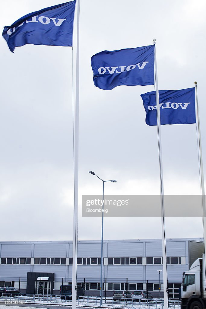 Branded flags fly outside Volvo AB's bus manufacturing plant in Wroclaw, Poland, on Friday, Jan. 11, 2013. Volvo plans to end bus making in Saeffle by June 2013, and will consolidate the business in Europe to its main plant in Wroclaw, Poland, the Gothenburg, Sweden-based company said. Photographer: Bartek Sadowski/Bloomberg via Getty Images