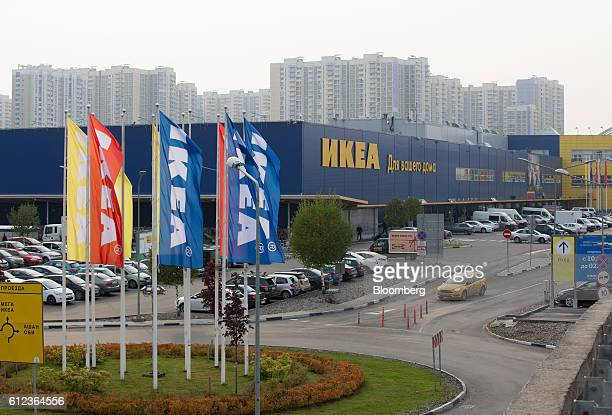 Branded flags sit on a roundabout at the entrance to the Ikea AB retail store in Khimki Russia on Monday Oct 3 2016 Ikea's Russia unit may spend 100...