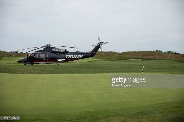 Branded helicopter sits near a putting green during a ribbon cutting event for a new clubhouse at Trump Golf Links at Ferry Point, June 11, 2018 in...