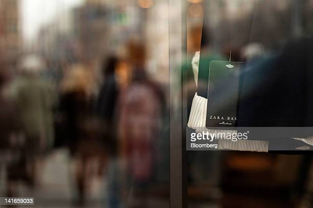 Branded labels hang from garments for sale inside a Zara fashion store operated by Inditex SA in Wroclaw Poland on Wednesday March 21 2012 Inditex SA...