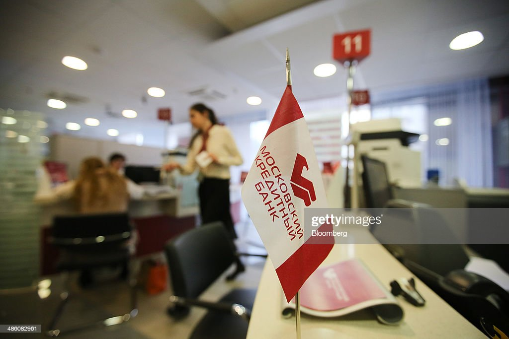 A branded miniature flag stands on a service desk inside a Credit Bank of Moscow bank branch in Moscow, Russia, on Tuesday, April 22, 2014. Bankers collected $108 million on Russian deals through April 20, compared with $325 million a year earlier, according to data from Freeman & Co., a New York consulting firm. Photographer: Andrey Rudakov/Bloomberg via Getty Images