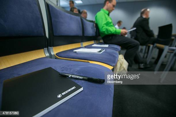 Branded note pads and pens sit on chairs during Rocket Internet SE's annual general meeting in Berlin Germany on Tuesday June 23 2015 Once termed...