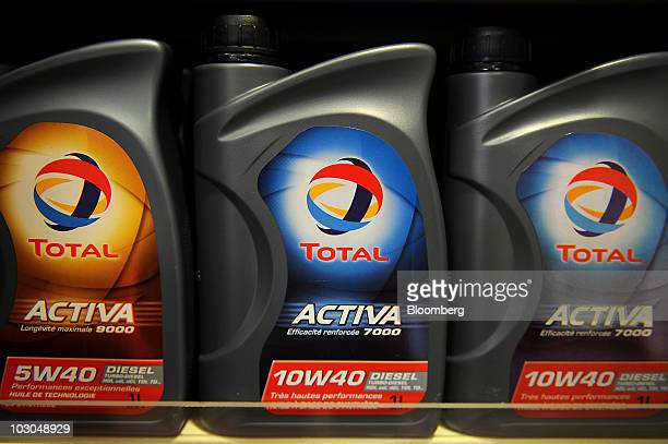 Branded oil products sit on display at a Total SA gas station in Paris France on Thursday July 22 2010 The company Europe's biggest oil refiner...
