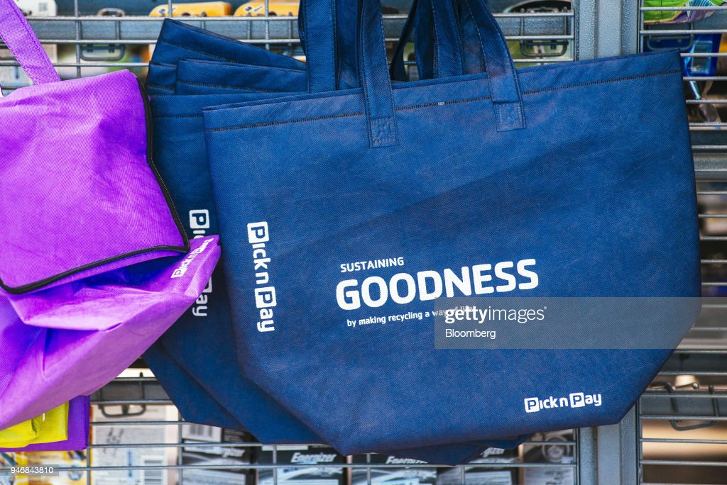 A branded reusable shopping tote bag hangs on display inside a Pick n Pay Stores Ltd. supermarket in Johannesburg, South Africa, on Monday, April 9, 2018. As trade tensions and the Syrian conflict roiled markets this month, South Africas rand has been stuck in an unusually narrow range for one of the worlds most volatile currencies. Photographer: Waldo Swiegers/Bloomberg via Getty Images
