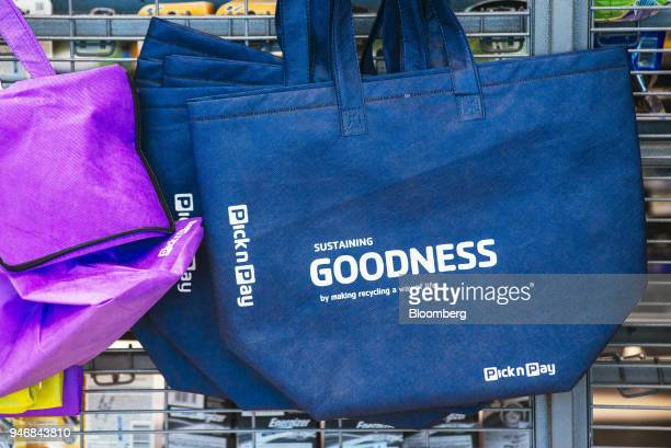 A branded reusable shopping tote bag hangs on display inside a Pick n Pay Stores Ltd supermarket in Johannesburg South Africa on Monday April 9 2018...
