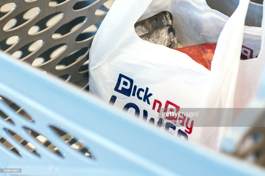 A branded shopping bag sits inside a basket at the check out area inside a Pick n Pay Stores Ltd. supermarket in Johannesburg, South Africa, on Monday, April 9, 2018. As trade tensions and the Syrian conflict roiled markets this month, South Africas rand has been stuck in an unusually narrow range for one of the worlds most volatile currencies. Photographer: Waldo Swiegers/Bloomberg via Getty Images
