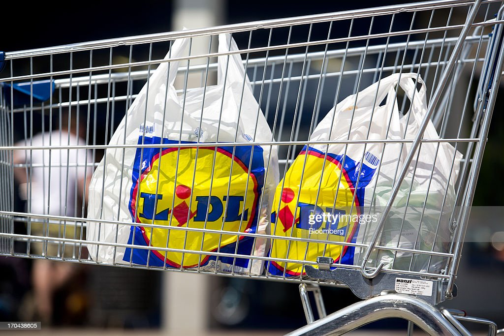 Branded shopping bags sit in a cart outside a Lidl discount supermarket store, operated by Schwarz Group, in Prague, Czech Republic, on Thursday, June 13, 2013. Ahold and Tesco are tied as the Czech Republic's third-largest grocer by revenue behind Lidl discount store owner Schwarz Group and Rewe AV, which owns the Billa supermarkets, according to Krakow, Poland-based market researcher PMR. Photographer: Martin Divisek/Bloomberg via Getty Images