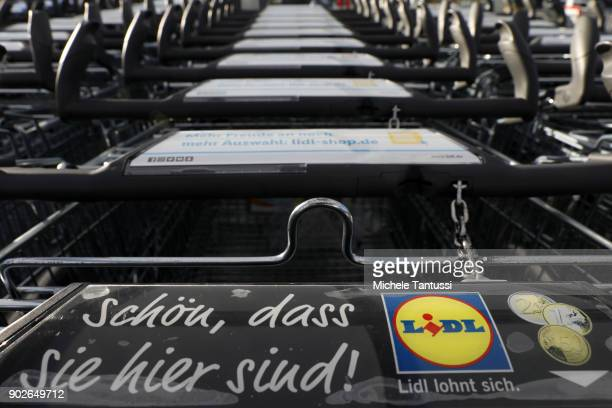 LIDL branded Shopping trolleys stand outside a Discount supermarket on January 8 2018 in Berlin Germany According to government statisticians nominal...