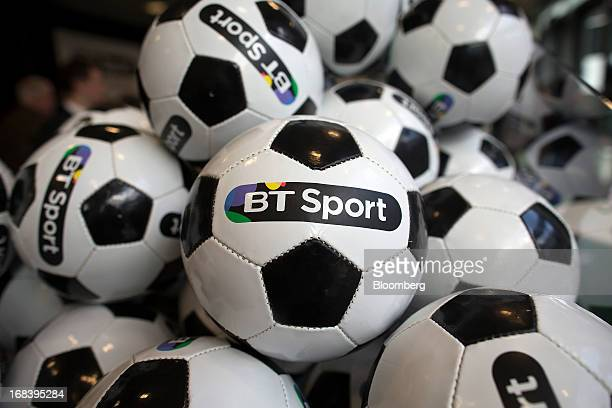 Branded soccer balls sit on display during the launch of BT Group Plc's new sports television channel BT Sport at the company's offices in London UK...