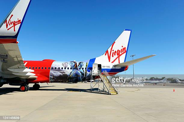 A branded Virgin Airlines plane carrying competition winners sits on the runway during the launch of the 'Avatar' Bluray and DVD at Sydney Domestic...