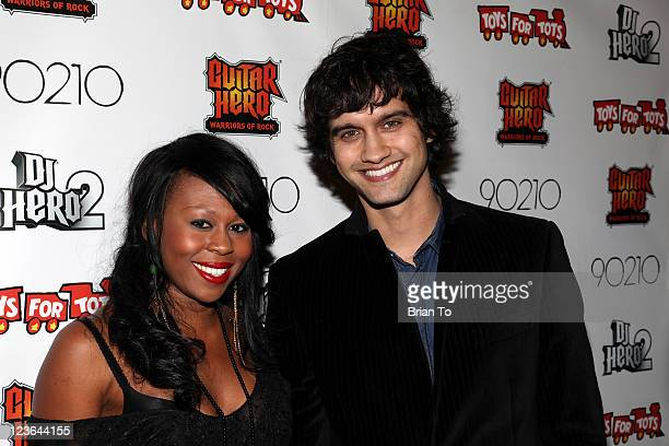 Brandee Tucker and Michael Steger attend 9021HO HO HO Toy Drive benefiting Toys for Tots on December 11 2010 in Los Angeles California