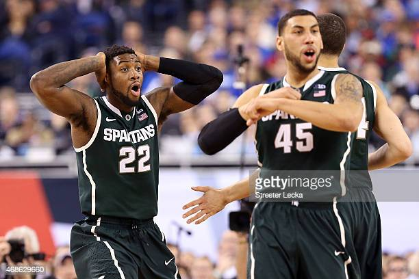 Branden Dawson and Denzel Valentine of the Michigan State Spartans react after a play in the second half against the Duke Blue Devils during the NCAA...