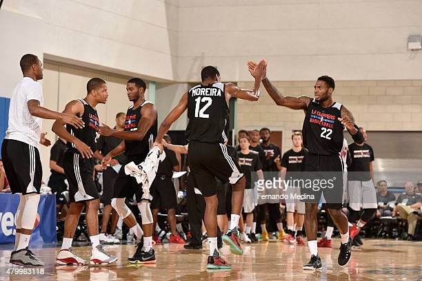 Branden Dawson of the Los Angeles Clippers celebrates with his teammates in a 2015 NBA Orlando Pro Summer League game against the Miami Heat on July...