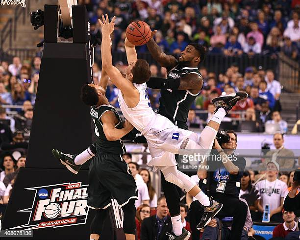 Branden Dawson of the Michigan State Spartans blocks a shot by Grayson Allen of the Duke Blue Devils during the NCAA Men's Final Four Semifinal at...