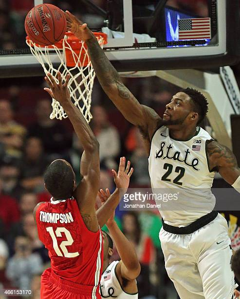 Branden Dawson of the Michigan State Spartans blocks a shot by Sam Thompson of the Ohio State Buckeyes during the quarterfinal round of the 2015 Big...