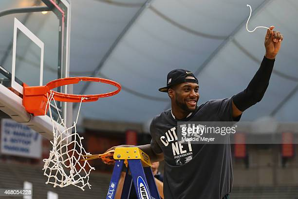 Branden Dawson of the Michigan State Spartans celebrates by cutting down the net after defeating the Louisville Cardinals 76 to 70 in overtime of the...