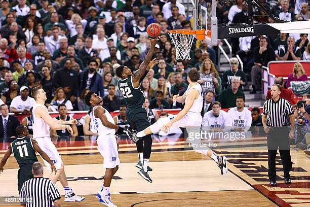 Branden Dawson of the Michigan State Spartans drives to the basket against Grayson Allen of the Duke Blue Devils during the NCAA Men's Final Four...