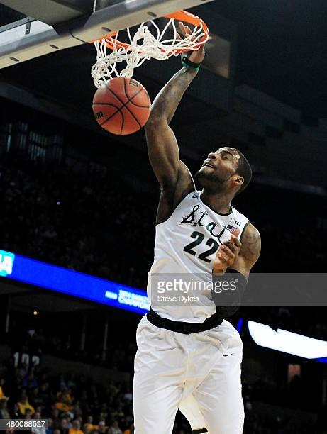 Branden Dawson of the Michigan State Spartans dunks against the Harvard Crimson in the first half during the Third Round of the 2014 NCAA Basketball...