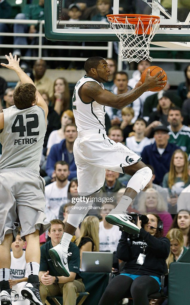 Branden Dawson #22 of the Michigan State Spartans gets to the basket past the defense of Corey Petros #42 of the Oakland Golden Grizzlies at the Jack T. Breslin Students Events Center on November 23, 2012 in East Lansing, Michigan.