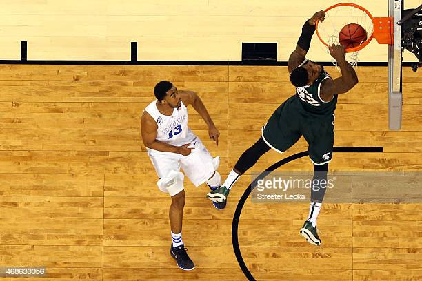 Branden Dawson of the Michigan State Spartans goes up for a dunk in the second half against Matt Jones of the Duke Blue Devils during the NCAA Men's...