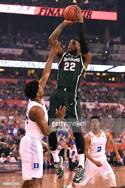 Branden Dawson of the Michigan State Spartans puts up a shot against Justise Winslow of the Duke Blue Devils during the NCAA Men's Final Four...