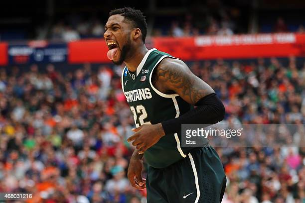 Branden Dawson of the Michigan State Spartans reacts after a basket in the first half of the game against the Louisville Cardinals during the East...