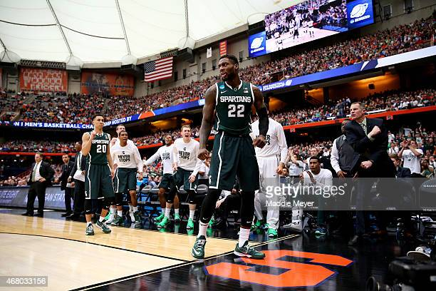 Branden Dawson of the Michigan State Spartans reacts after a basket in the second half of the game against the Louisville Cardinals during the East...