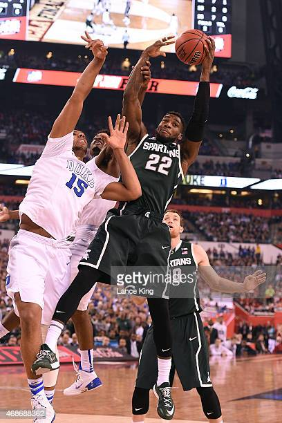 Branden Dawson of the Michigan State Spartans rebounds against Jahlil Okafor of the Duke Blue Devils during the NCAA Men's Final Four Semifinal at...