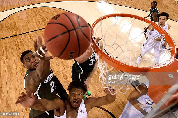 Branden Dawson of the Michigan State Spartans shoots over Justise Winslow of the Duke Blue Devils in the second half during the NCAA Men's Final Four...