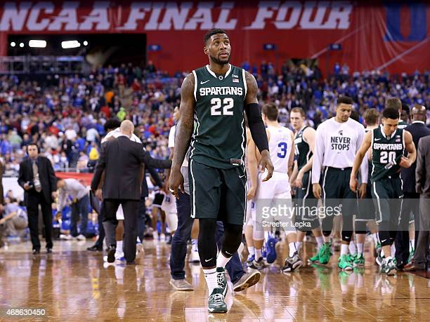 Branden Dawson of the Michigan State Spartans walks off the court after being defeated by the Duke Blue Devils during the NCAA Men's Final Four...