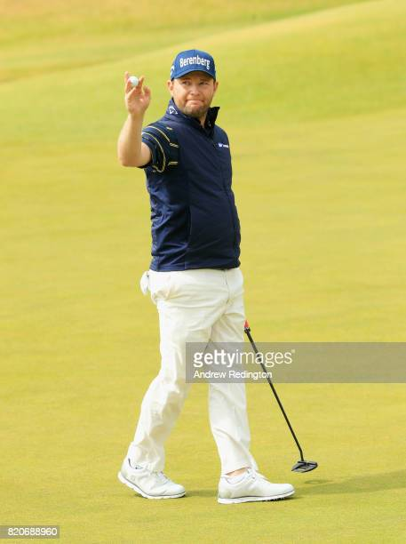 Branden Grace of South Africa acknowledges the crowd on the 18th green after shooting a 62 the lowest round in major history during the third round...