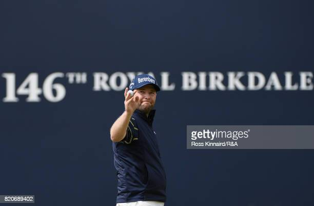 Branden Grace of South Africa acknowledges the crowd on the 18th green after shooting a 62 the lowest round in major championship history during the...