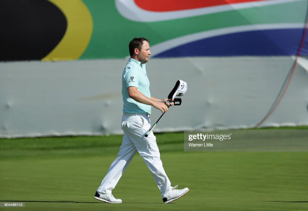 Branden Grace of South Africa acknowledges the crowd on thw 18th green during the third round of the BMW South African Open Championship at Glendower Golf Club on January 13, 2018 in Johannesburg, South Africa.