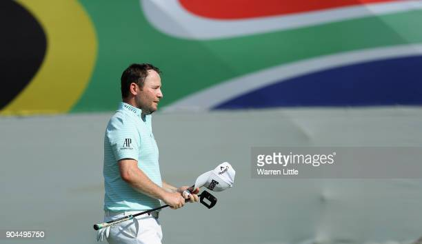 Branden Grace of South Africa acknowledges the crowd on thw 18th green during the third round of the BMW South African Open Championship at Glendower...