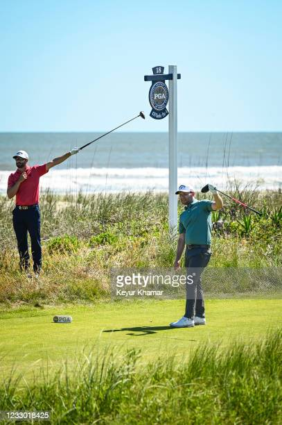 Branden Grace of South Africa and Adam Hadwin of Canada react fore left to Graces shot from the 18th tee during the first round of the PGA...