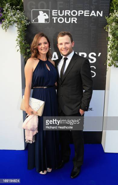 Branden Grace of South Africa and his girlfriend Nieke Coetzee arrive at the European Tour Dinner prior to the BMW PGA Championship at the Sofitel...