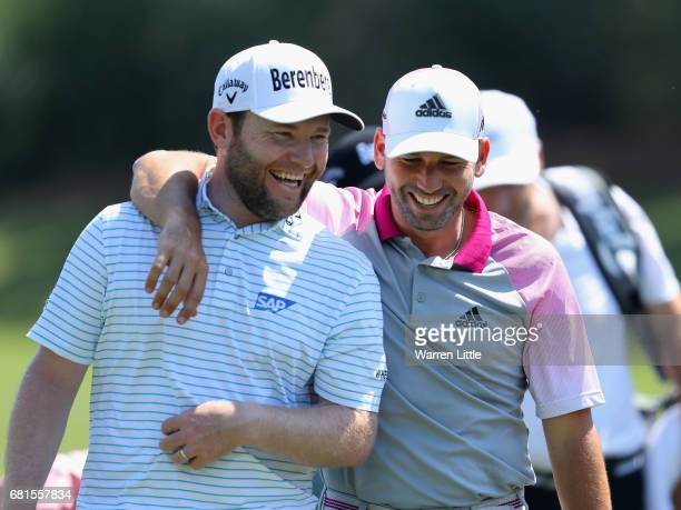 Branden Grace of South Africa and Sergio Garcia of Spain share a joke during a practice round ahead of THE PLAYERS Championship on the Stadium Course...